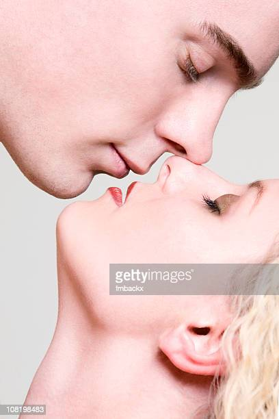 Portrait of Young Man and Woman About to Kiss
