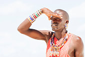 Portrait of young tribal man as Massai warrior in hot Kenya in Africa.
