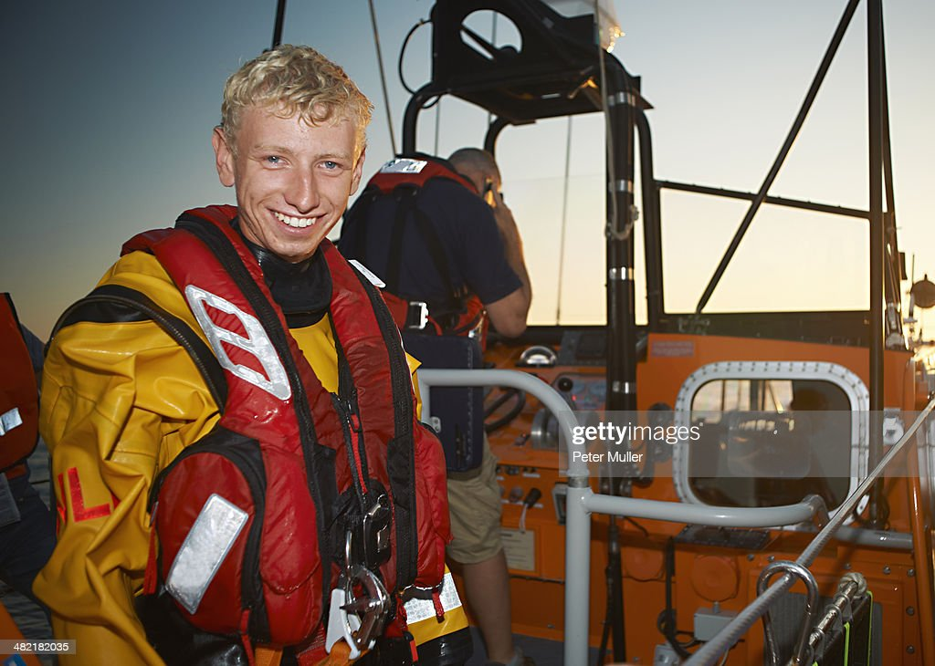 Portrait of young man crewing lifeboat at sea