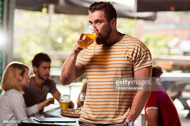 Portrait of young man drinking beer