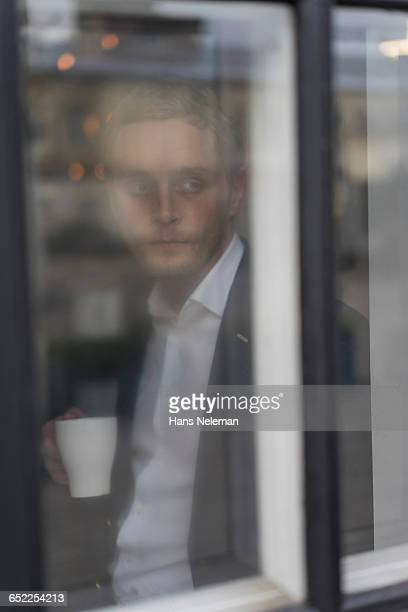 A portrait of young man drinking coffee