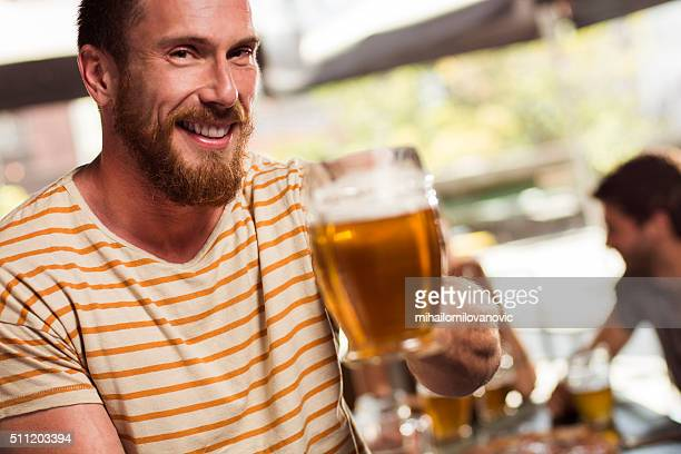 Portrait of young man in a bar