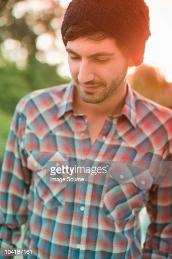 Portrait of young man in checked shirt