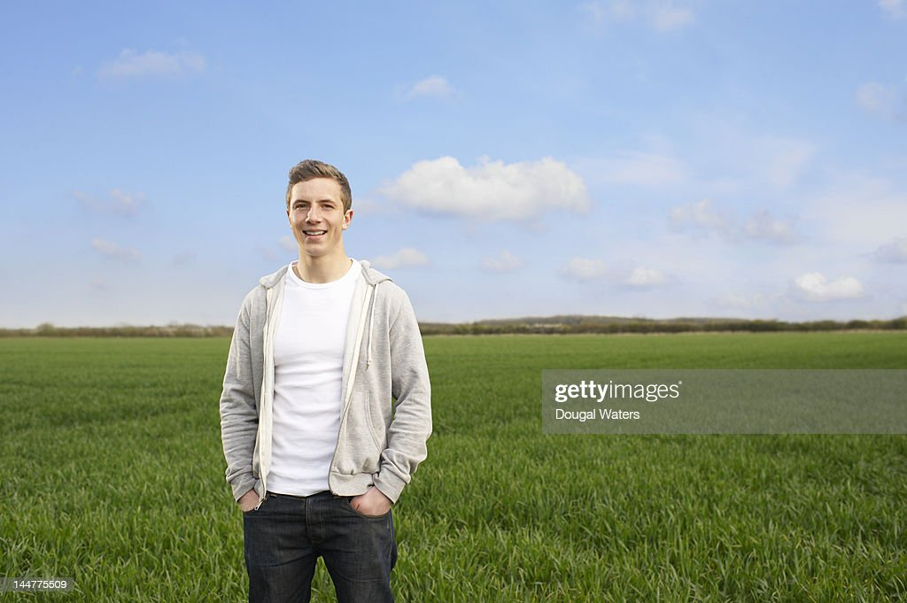 Portrait of young man in countryside. : Stock Photo