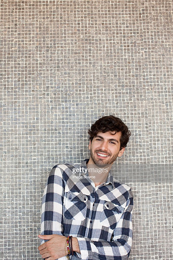 Portrait of young man in front of wall : Stock Photo