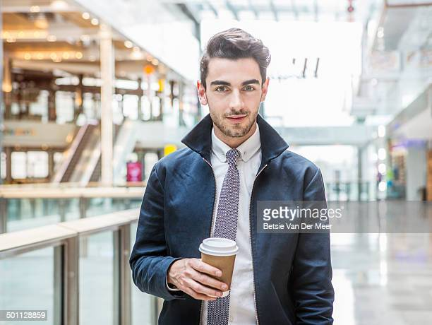 portrait of young man in indoor urban area.