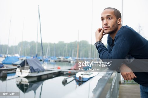 Portrait of young man in marina