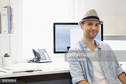 Portrait of young man in office : Stockfoto