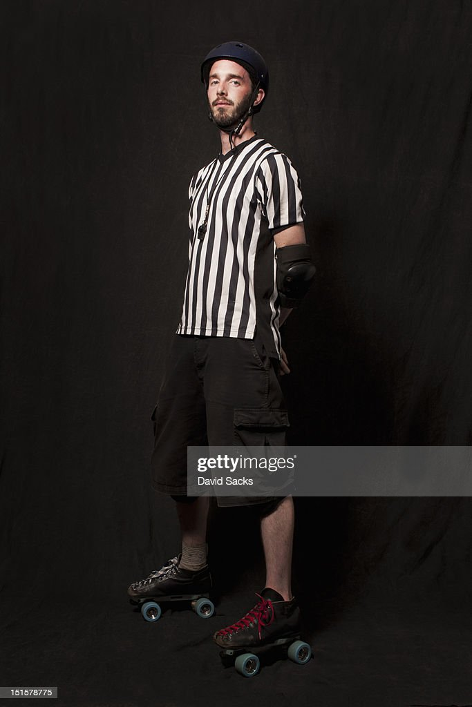 Portrait of young man in skates : Stock Photo