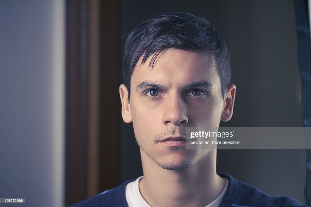 Portrait of young man, interior : Stock Photo