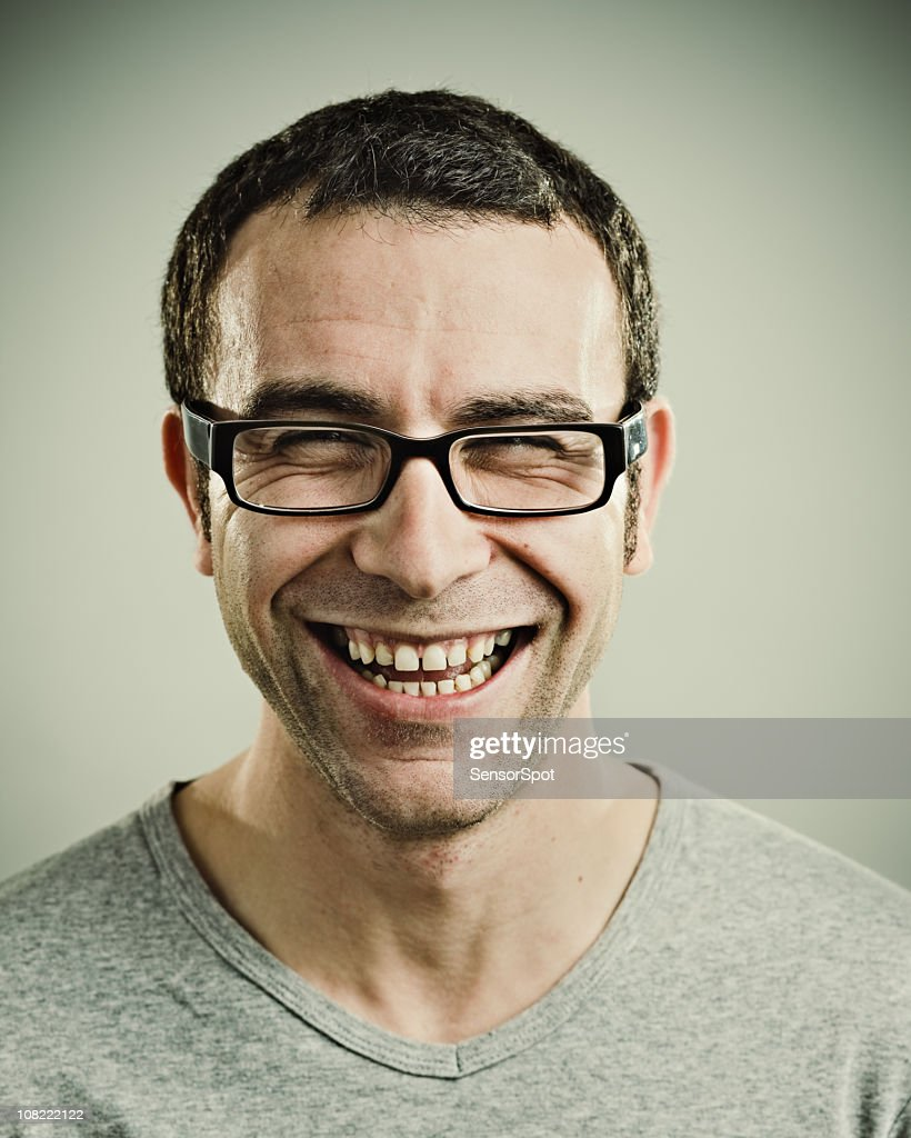 Portrait of Young Man laughing : Stock Photo