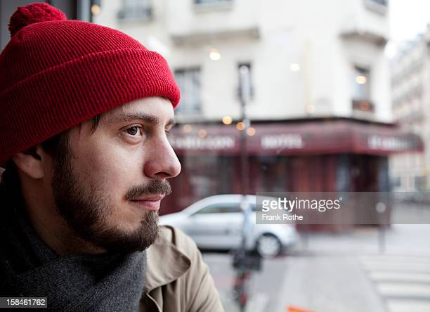 portrait of young man near a window to the street