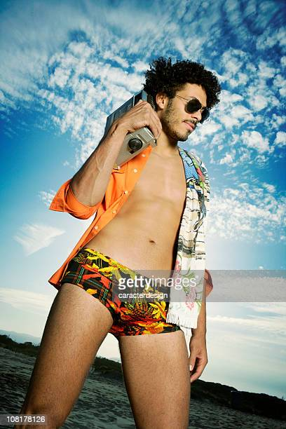 Portrait of Young Man on Beach Wearing Retro Bathing Suit
