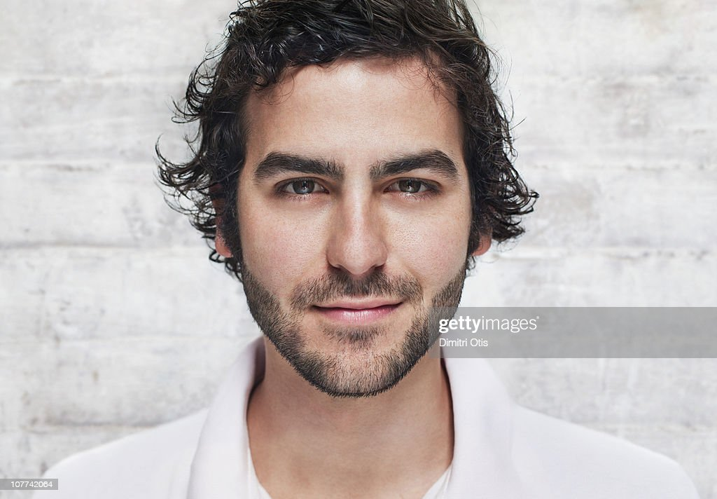 Portrait of young man smiling, close-up : Stock Photo