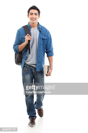 Portrait Of Young Man Walking With Bag And Book Over White ...