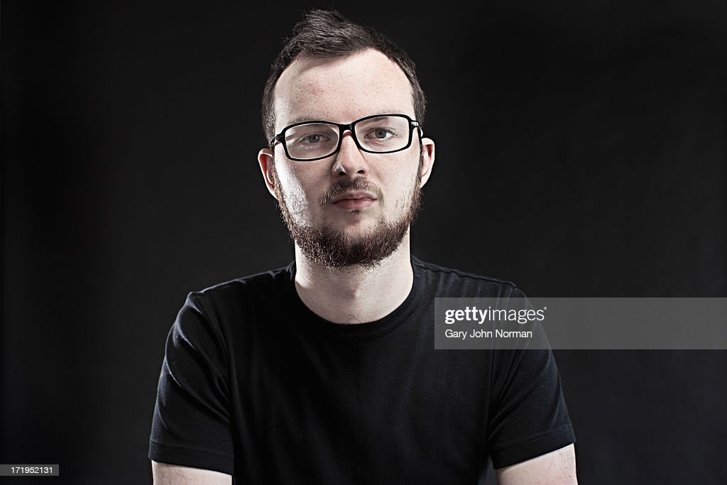 portrait of young man with beard and glasses : Stock Photo