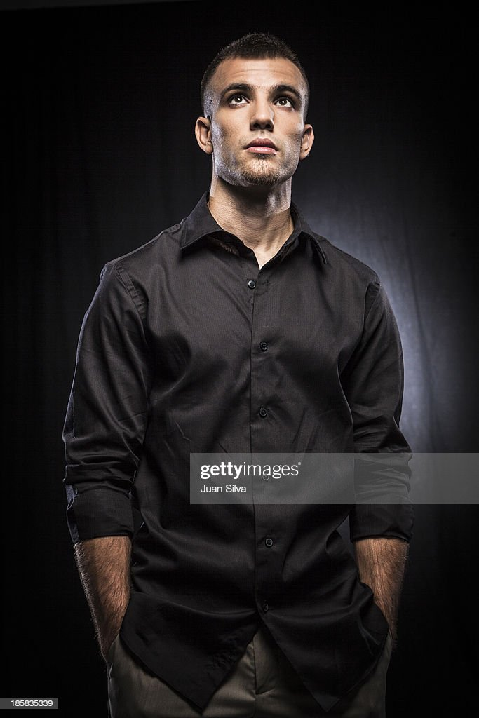 Portrait of young man with black shirt looking up
