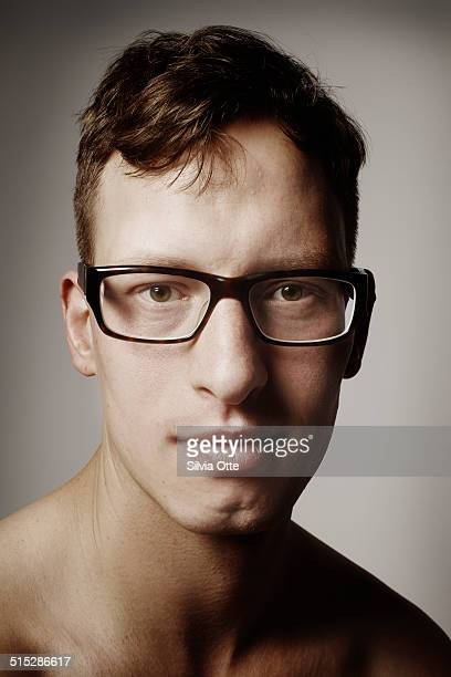 Portrait of young man with fashionable glasses