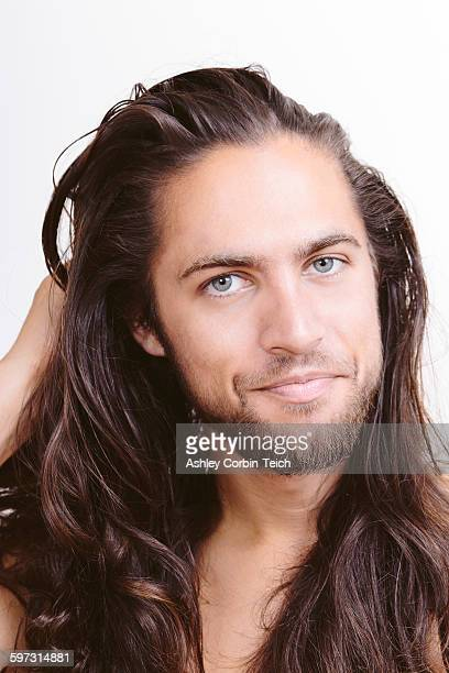Portrait of young man with long hair, close-up