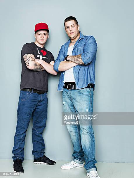 Portrait of young men with tattoos