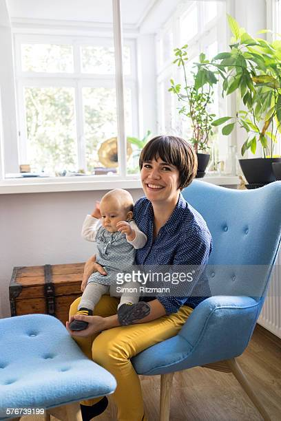 Portrait of young mother with baby daughter.