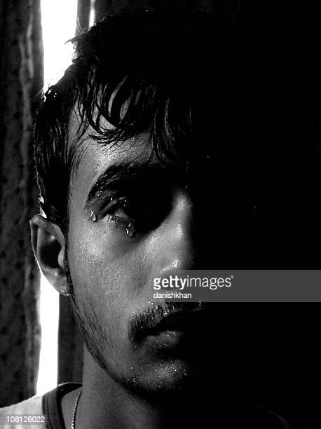 Portrait of Young Pakistani Man with Wet Face, Low Key