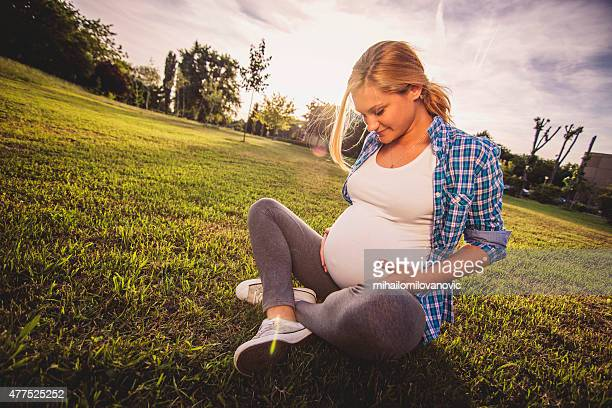 Portrait of young pregnant woman