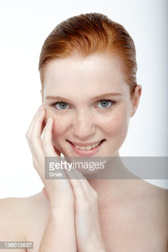 Portrait of young redhead girl smiling : Stock Photo