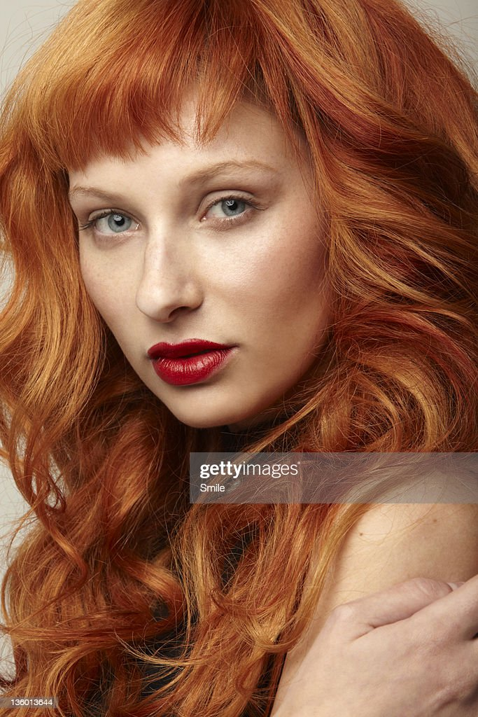 Portrait of young redhead with red lipstick : Stock Photo