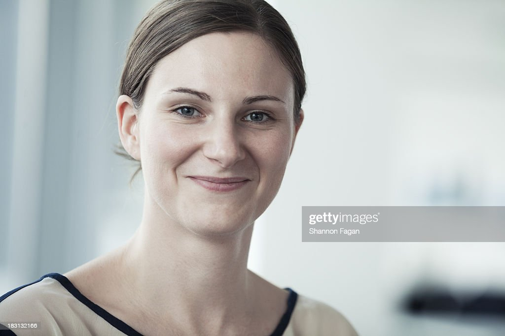 Portrait of young smiling businesswoman : Stock Photo
