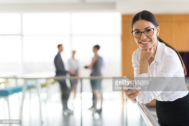 Portrait of young successful businesswoman at work