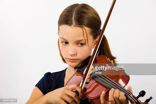 Portrait of young violinist with old and valuable violin..