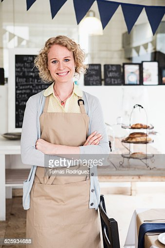 Portrait of young waitress standing in restaurant : Stock Photo