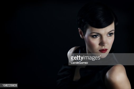 Portrait of Young Woman Against Black Background, Low Key