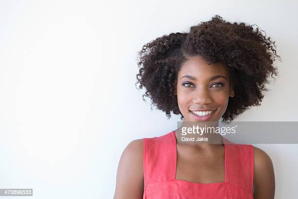 Portrait of young woman against white background
