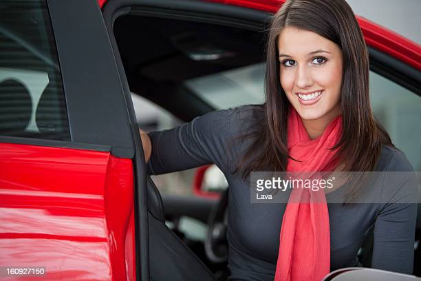 portrait of young woman at car dealer
