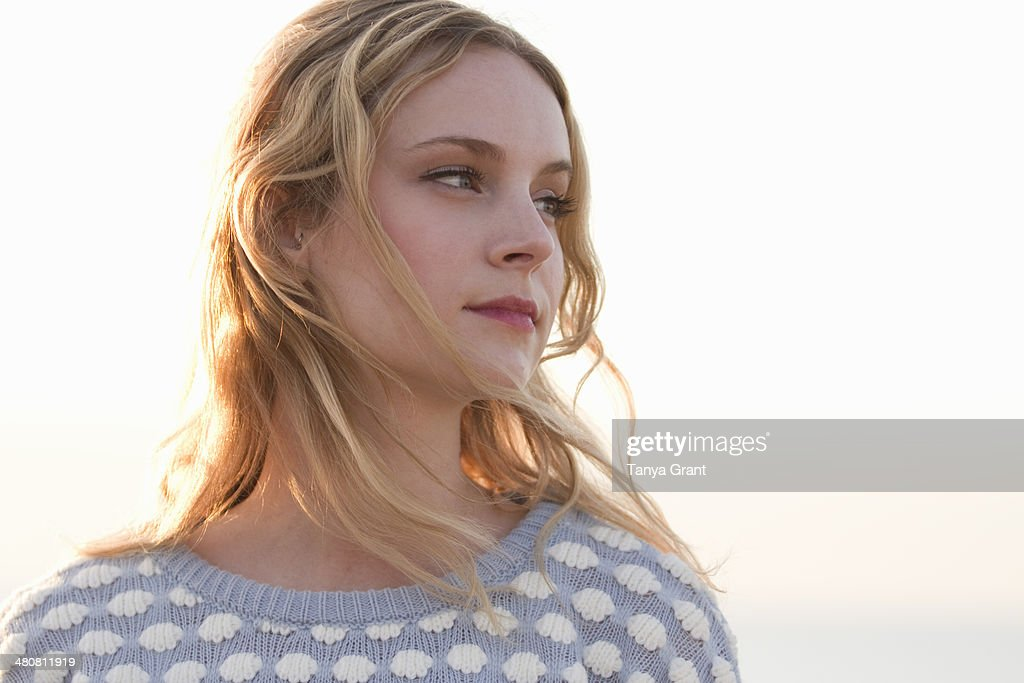 Portrait of young woman at coast, Whitstable, Kent, UK : Stock Photo