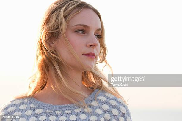Portrait of young woman at coast, Whitstable, Kent, UK