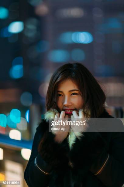 Portrait Of Young Woman At Cold Night