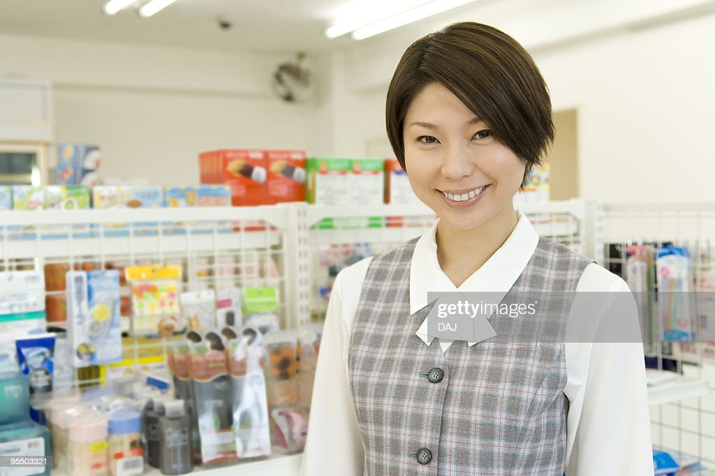 Portrait of young woman at convenience store : Stock Photo