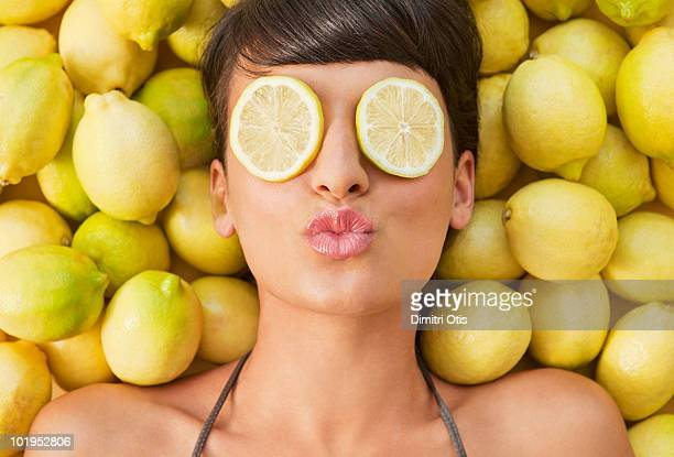 Portrait of young woman between lemons