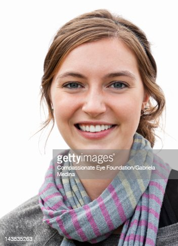 Portrait of young woman, close up, smiling : Stock Photo