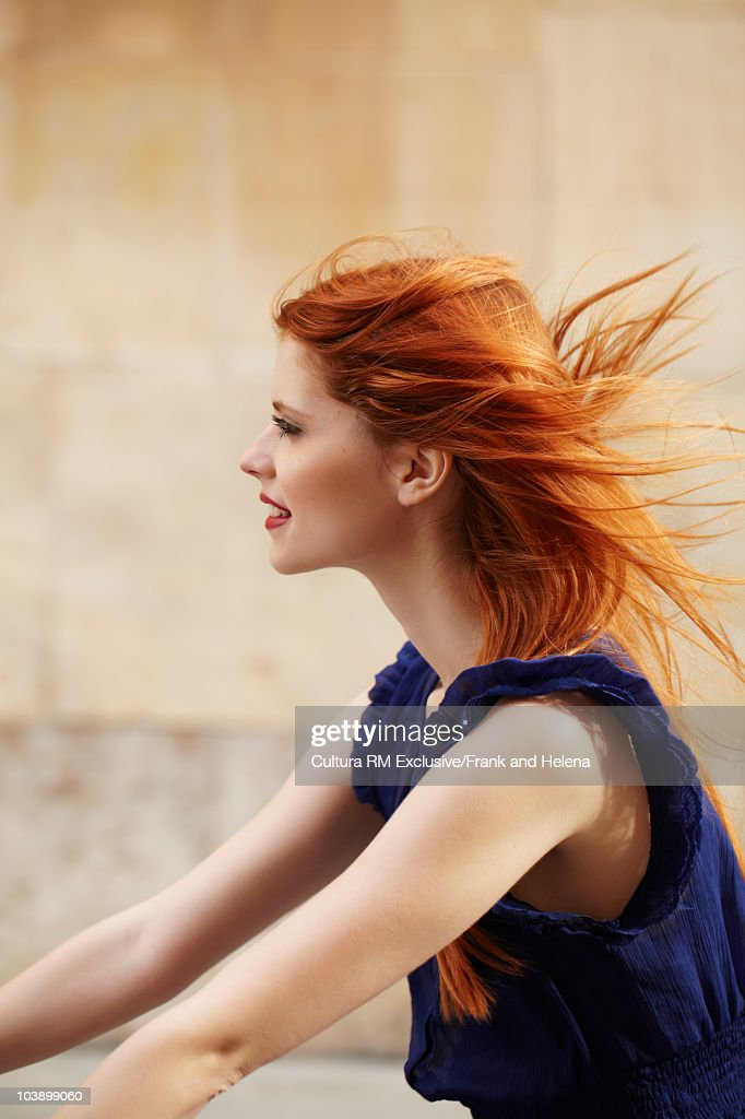 Portrait of young woman cycling : Stock Photo
