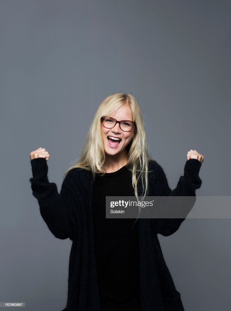 Portrait of young woman dancing, studio background : Stock Photo