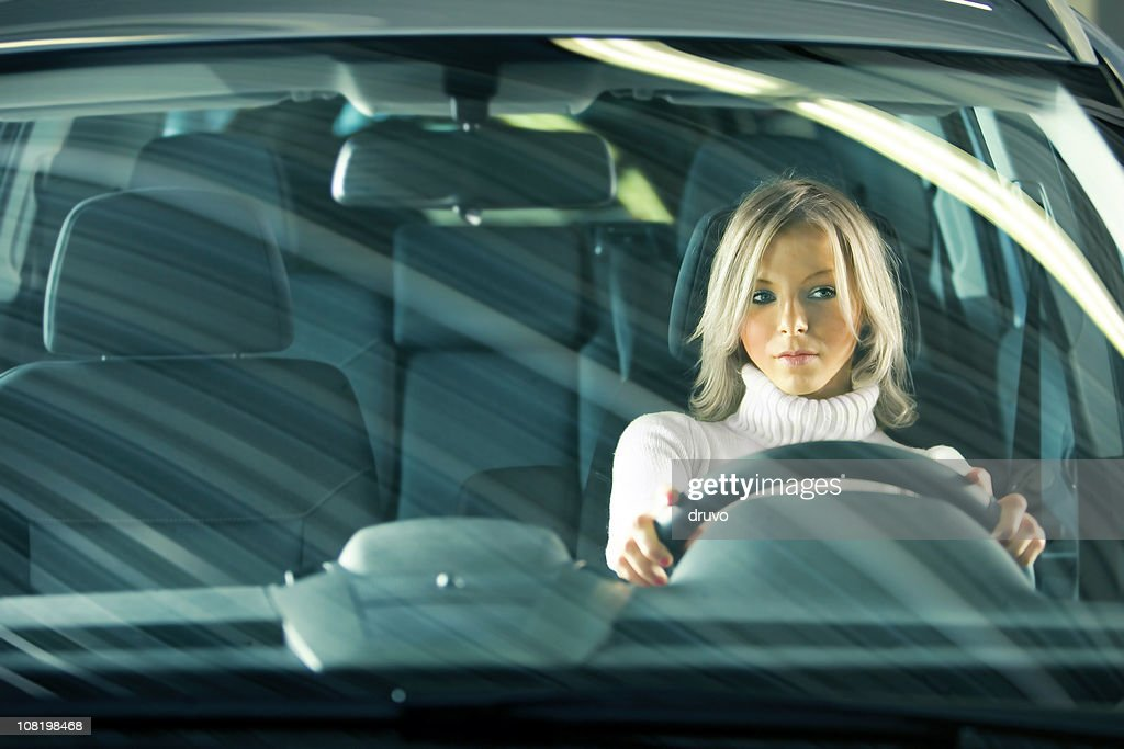 Portrait of Young Woman Driving Car : Foto stock