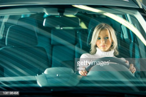 Portrait of Young Woman Driving Car : Stock Photo