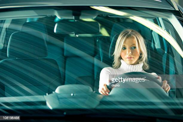 Portrait of Young Woman Driving Car
