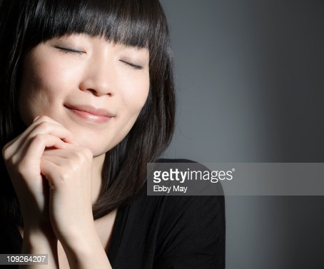 Portrait of young woman, eyes closed : ストックフォト