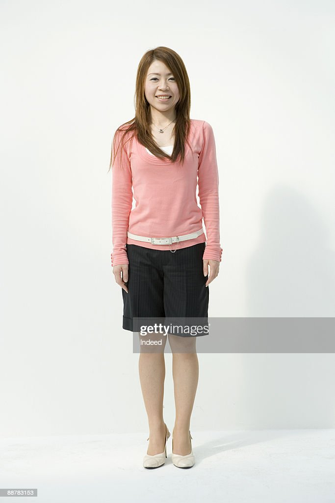 Portrait of young woman, full length : Stock Photo
