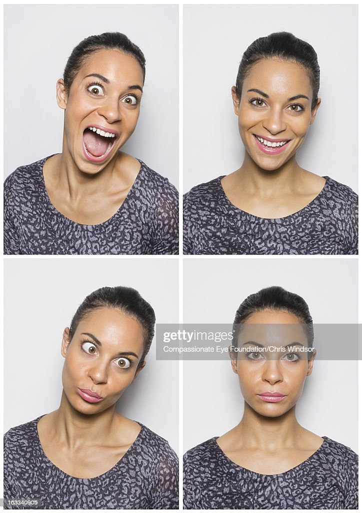Portrait of young woman having fun in photo booth : Stock Photo